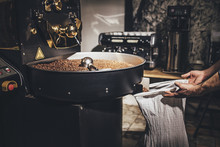 Man Working At Coffee Roaster