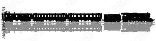 Fototapeta The black silhouette of a vintage passenger steam train obraz