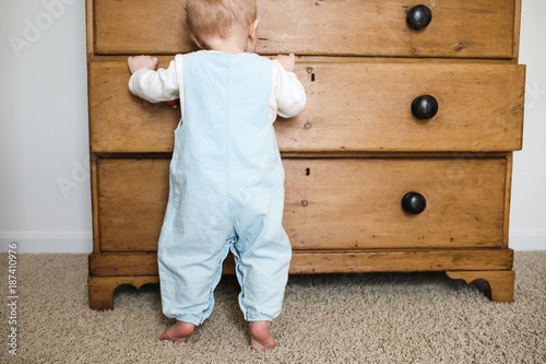 baby looking in a drawer