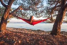 Beautiful Young Woman Relaxing In Red Hammock