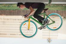 Young Man Riding His Bicycle U...