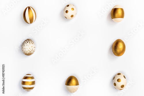 Top view of easter eggs colored with golden paint in differen patterns arranged in square Canvas Print
