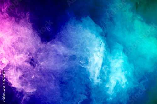 Poster Fumee Colorful smoke clouds on dark background