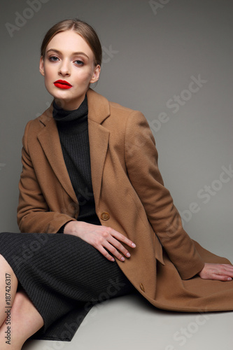 Fashionable woman in a coat. Wall mural