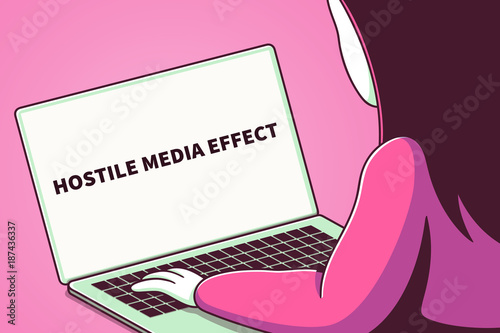 Fotografie, Obraz  Woman looking at a laptop screen with the words hostile media effect