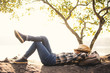 canvas print picture - Boy backpacker sleeping on the rock in nature , Relax time on holiday concept travel,selective and soft focus,tone of hipster style