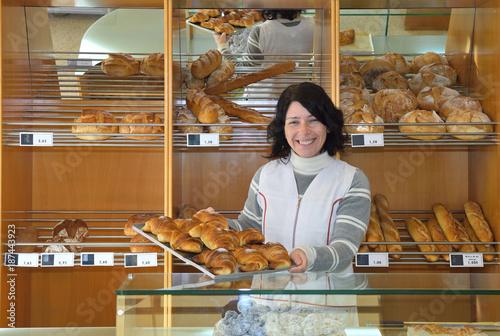 Staande foto Bakkerij a baker in her bakery