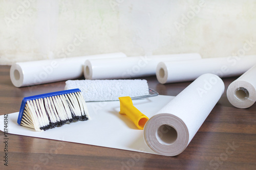 Fotografie, Obraz  preparation for home repair, wallpaper rolls and brush on the floor