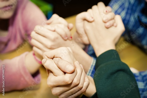 Fotografie, Tablou  young friends with hands together, fellowship