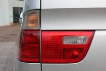Gray Car. Car Headlights. Luxury Headlights