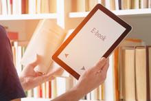 Man Holding A Modern Ebook Rea...