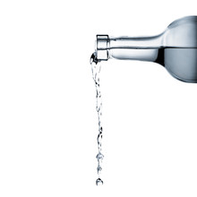Water Pouring From Glass Bottl...