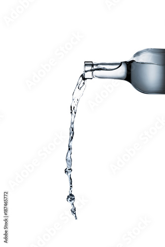water pouring from glass bottle isolated on white Wallpaper Mural
