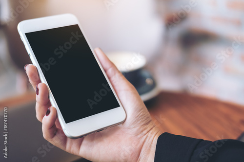 Mockup Image Of A Woman S Hand Holding White Mobile Phone With Blank Black Desktop Screen And