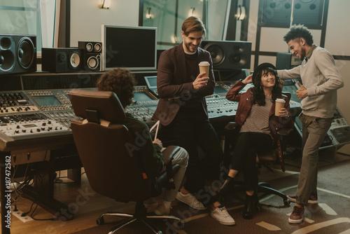 sound producers spending time at recording studio Fototapeta