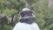 Head And Shoulder Portrait Of Beekeeper In Protective Clothing