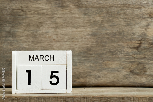 Fényképezés  White block calendar present date 15 and month March on wood background