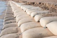 Line Big Sandbag Prevent Waves At Cha Am Beach Of Thailand.