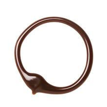 Chocolate Caramel Sauce Circle On A Plain White Backround