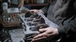 a close shot at the hands of a man who collects the engine of a motor vehicle that was given to a service center for repair