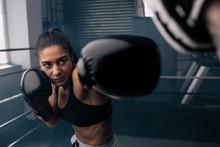 Female Boxer Training Inside A...