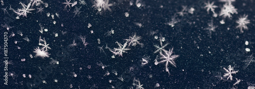 natural crystals, snowflakes lying on a blue background
