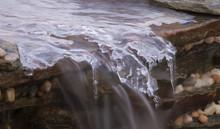Frozen Cascade With Water Flow...