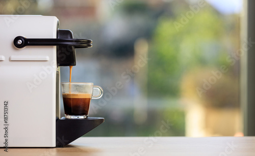 Slika na platnu Espresso coffee machine on a wooden table, blur background, space for text