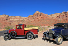 Old Vintage Cars Driving Moki Dugway Road Leading To The Valley Of The Gods, Utah, USA