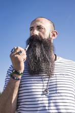 Bearded Man Smoking Pipe.
