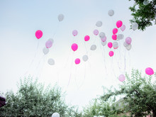 Pink And White Balloons Fly Aw...
