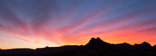 The Predawn Sky Above Gooseberry Mesa Is Painted Bright Colors With Sunrise Light.
