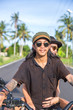 Young couple traveling by motorcycle