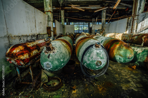 Photo  Old rusted submarine torpedoes in abandoned torpedo factory