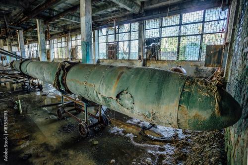 Photo  Old rusted submarine torpedo in abandoned torpedo factory