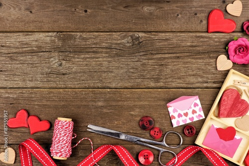 Valentines Day craft concept corner border against a rustic wood background with copy space Canvas Print