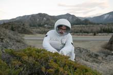 Cosmonaut Taking Grass Samples