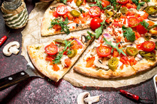 Fresh Pizza With Ham And Vegetables.
