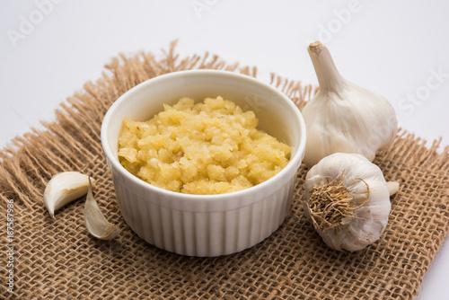 Garlic Paste or Toum or Toumya with raw garlic, isolated over white background