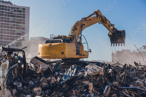 Excavator working on a demolition site Wallpaper Mural
