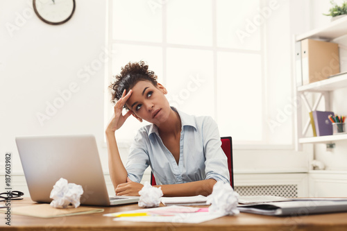 Fotografie, Obraz  Frustrated business woman with headache at office