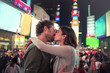 Couple kissing in Times Square, New York, United States, North America