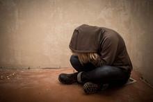 Portrait Of Man Sad, Drug Addict Man Sitting On The Floor In Corner