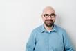 Leinwanddruck Bild - Smiling middle aged bald man in glasses