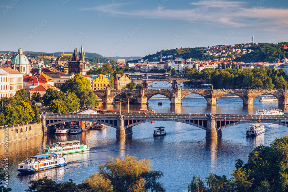 Fototapeta View of the Vltava River and the bridges shined with the sunset sun, Prague, the Czech Republic - obraz na płótnie
