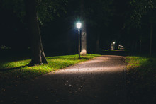 Night View Of A Dutch Park And Lightning Lamp Posts.