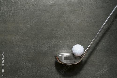 Deurstickers Golf golf ball and golf club on black background