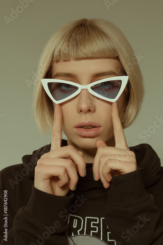 677079b19597 Blonde girl with short hair style in fashion glasses - Buy this ...
