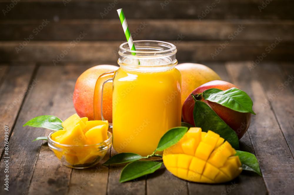 Fototapeta Fresh mango smoothie in the glass
