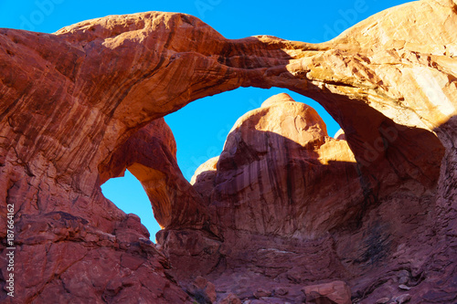Magenta The amazing architecture of the double arch in Arches National Park on a bright autumn afternoon..